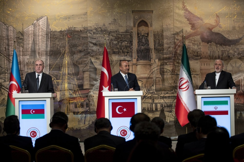 Foreign Minister Mevlu00fct u00c7avuu015fou011flu (C), his Azeri counterpart Elmar Mammadyarov (L) and Iranian Foreign Minister Mohammad Javad Zarif (R) attend a press conference after their meeting in Istanbul, Oct. 30.