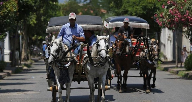 Horse carriages have been the main mode of transportation on the Princes' Islands for years. AP Photo
