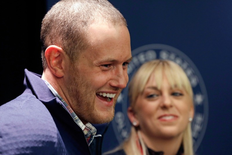 U.S. figure skating pairs Caydee Denney and John Coughlin speak with reporters during a news conference in Park City, Utah. (AP Photo)