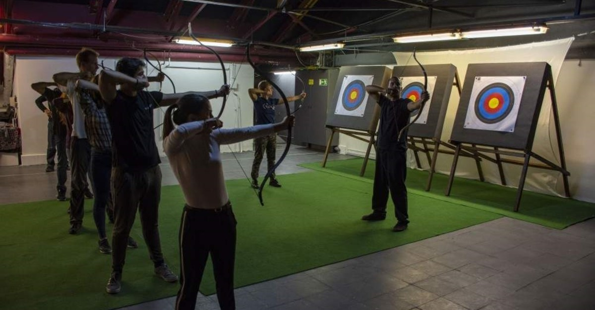An instructor shows trainees how to shoot at a shooting range, Budapest, Oct. 29, 2019. (AA Photo)