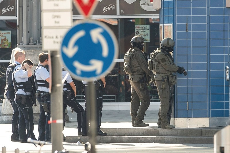 Special police operate outside the Cologne, western Germany, train station Monday, Oct. 15, 2018. (AP Photo)