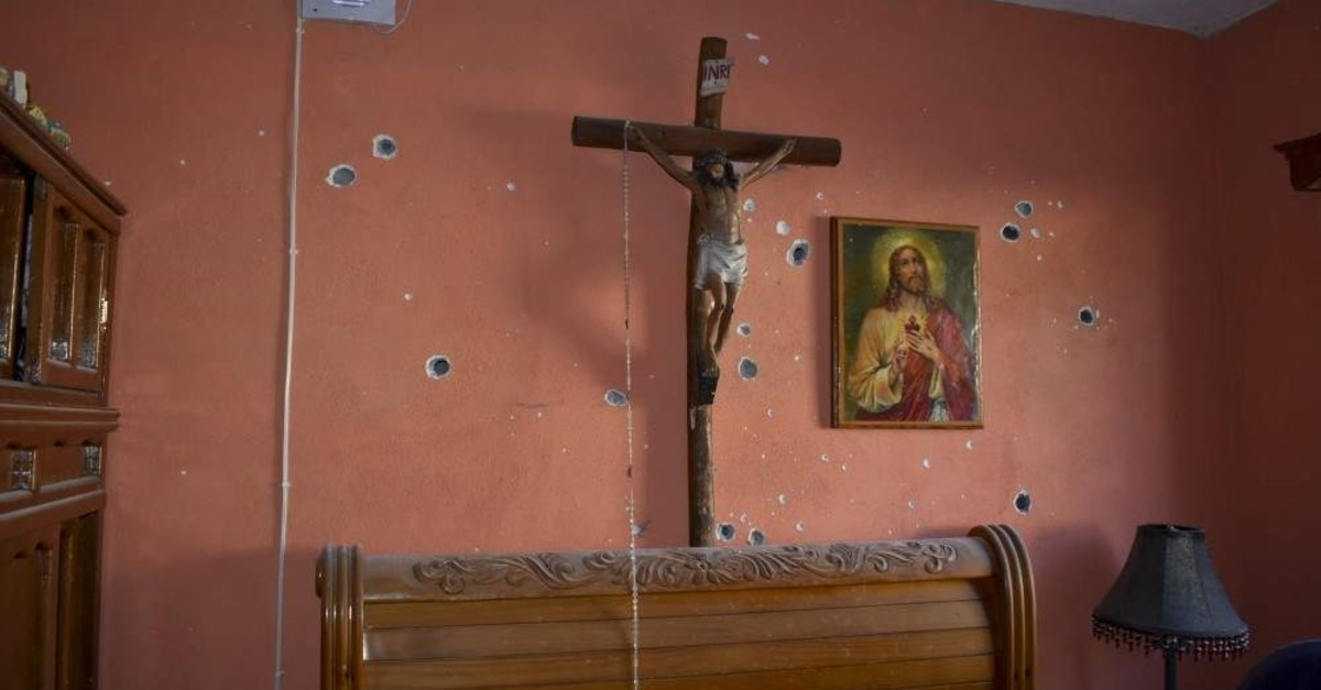A wall of the room of a home is riddled with bullet holes after a gun battle between Mexican security forces and suspected cartel gunmen, in Villa Union, Mexico, Saturday, Nov. 30, 2019. (AP Photo)