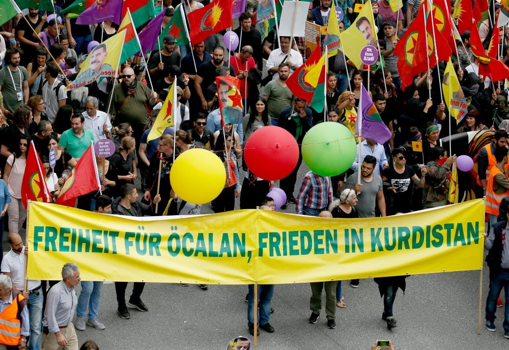 A group of PKK supporters march with a banner reading ,Freedom for u00d6calan, peace in Kurdistan, on the ,Unlimited solidarity instead of G20, demonstration during the G20 Summit in Hamburg, Germany, July 8, 2017.