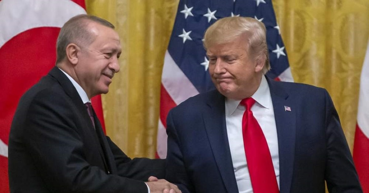 U.S. President Donald J. Trump (R) and President Recep Tayyip Erdogan (L) shake hands after their joint press conference in the East Room of the White House in Washington, Nov. 13, 2019. (IHA Photo)