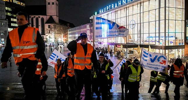 Striking members of the German Railway and Transport Union (EVG) gather in front of the Cologne central train station as they protest during a warning strike in railway operations in Germany, in Cologne, Germany, Dec. 10, 2018. (EPA Photo)