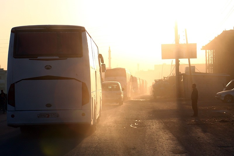 Buses carrying Jaish al-Islam fighters and their families, from the former rebel bastion's main town of Douma, arrive in the Syrian town of Azaz on April 5, 2018 on their way to a refugee camp (AFP Photo)