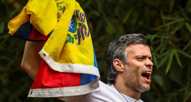A file photograph shows opposition leader Leopoldo Lopez greeting sympathizers from his home in Caracas after being granted house arrest, in Venezuela, on July 8, 2017. (EPA Photo)