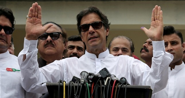 This file photo shows Imran Khan, chairman of Pakistan Tehreek-e-Insaf (PTI), speaks to members of media after casting his vote at a polling station during the general election in Islamabad, Pakistan, July 25, 2018. (Reuters Photo)