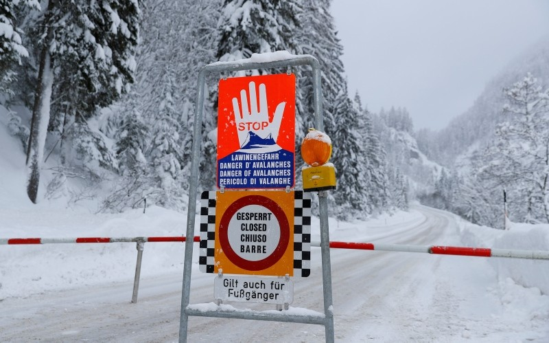 A sign warning of avalanche danger is seen on a closed road after heavy snowfall near Obertauern, Austria, January 9, 2019 (Reuters File Photo)