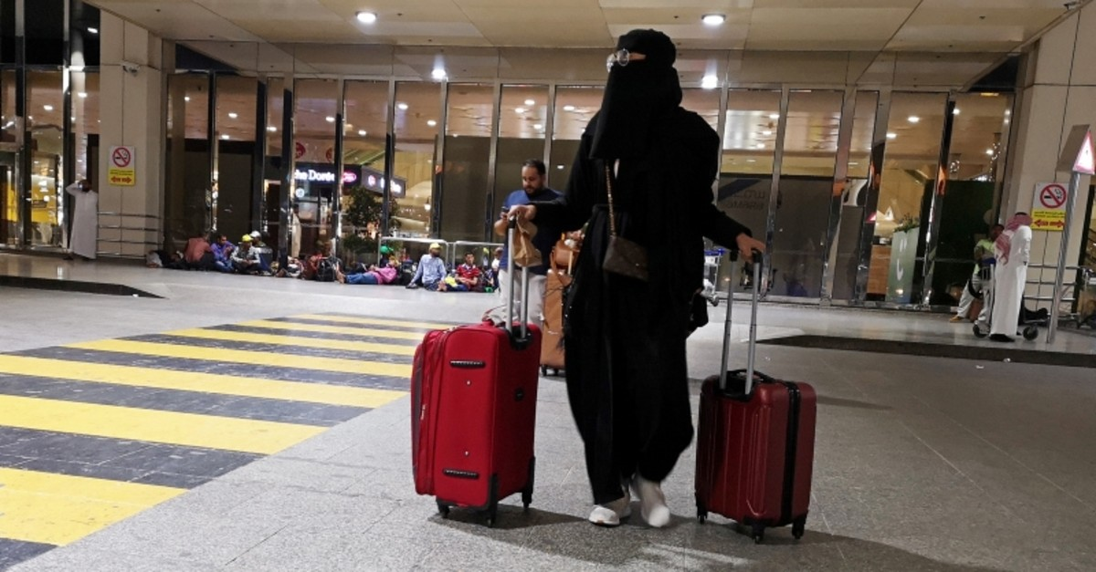 A Saudi woman walks with her luggage as she arrives at King Fahd International Airport in Dammam, Saudi Arabia, August 5, 2019. (Reuters Photo)