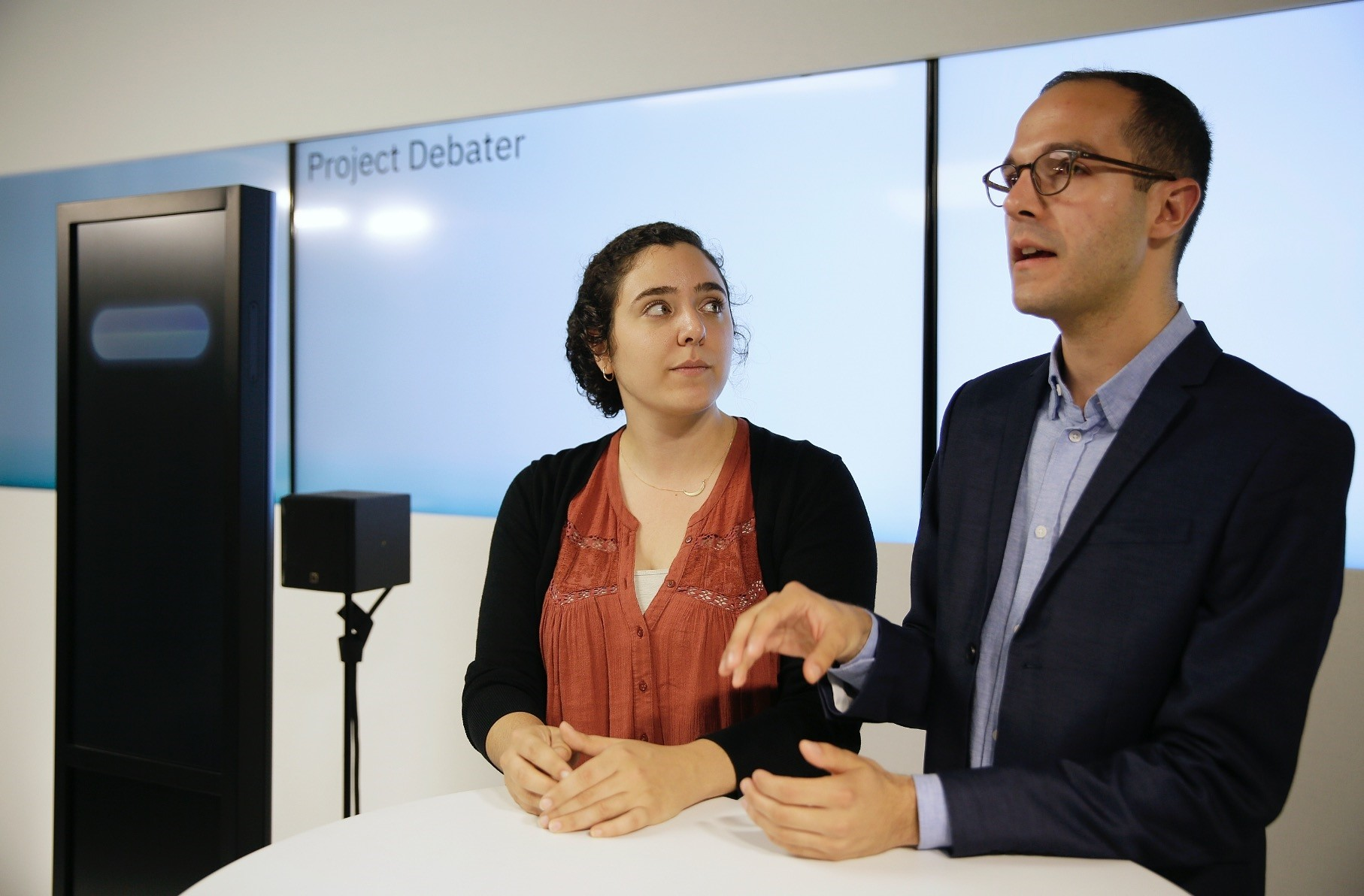 Noa Ovadia (L) and Dan Zafrir prepare for their debate against the IBM Project Debater in San Francisco, June 18.