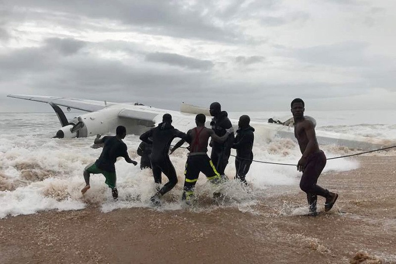 People pull the wreckage of a propeller-engine cargo plane after it crashed in the sea near the international airport in Ivory Coast's main city, Abidjan, October 14, 2017.