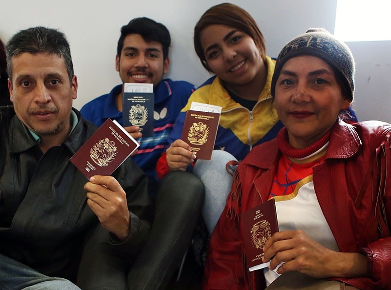 Venezuelan migrants wait to enter the boarding area of international airport in Lima after choosing to return to their country with plane ticket paid by their government, on Aug. 27, 2018. (AFP Photo)
