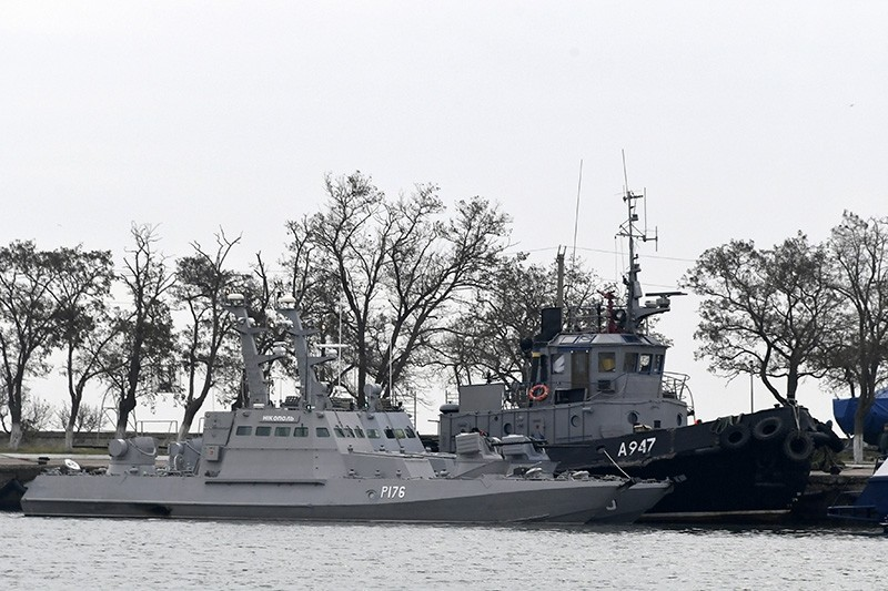 Three Ukrainian ships are seen as they docked near the Kerch after been seized ate Sunday, Nov. 25, 2018, in Kerch, Crimea, Monday, Nov. 26, 2018. (AP Photo)
