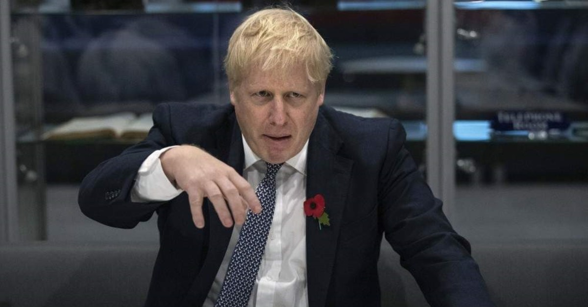 Britain's Prime Minister Boris Johnson during a visit to the Metropolitan Police training college in Hendon, north London, Thursday, Oct. 31, 2019. ( Aaron Chown / Pool Photo via AP)