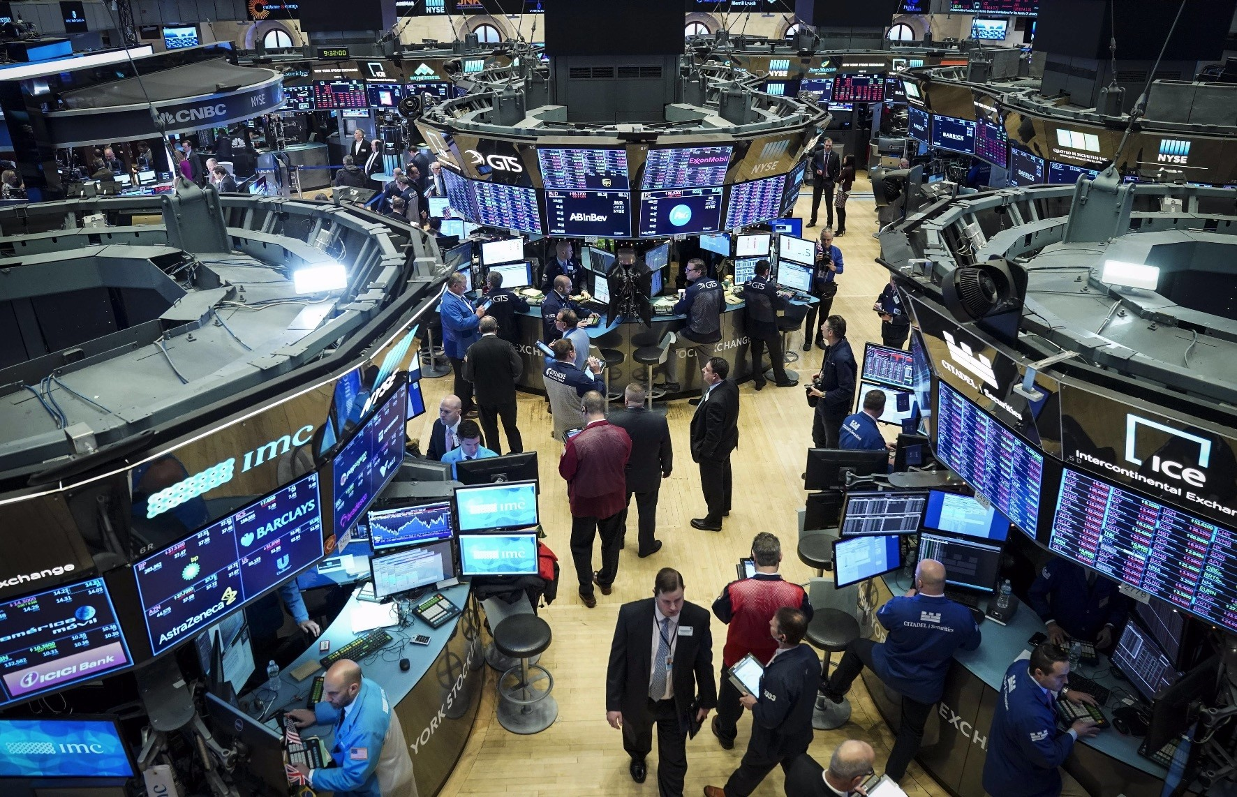 Traders and financial professionals work at the opening bell on the floor of the New York Stock Exchange, New York City, Jan. 2.