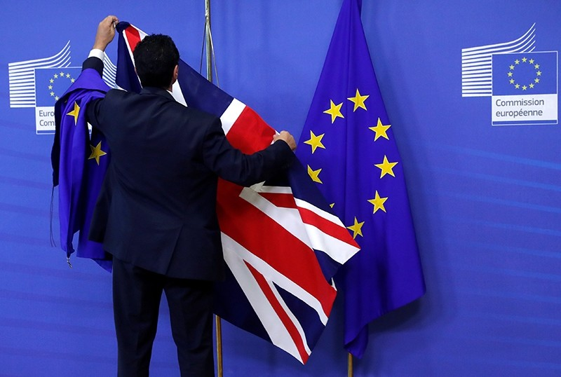 Flags are arranged at the EU Commission headquarters ahead of a first full round of talks on Brexit, Britain's divorce terms from the European Union, in Brussels, July 17, 2017. (REUTERS Photo)