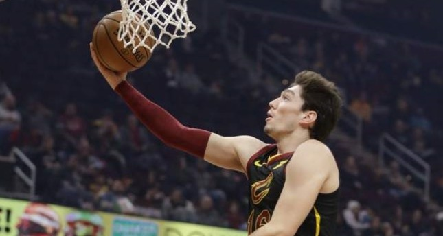 Cavaliers' Cedi Osman drives to the basket against the Hornets in Cleveland, Dec. 18, 2019. AP Photo
