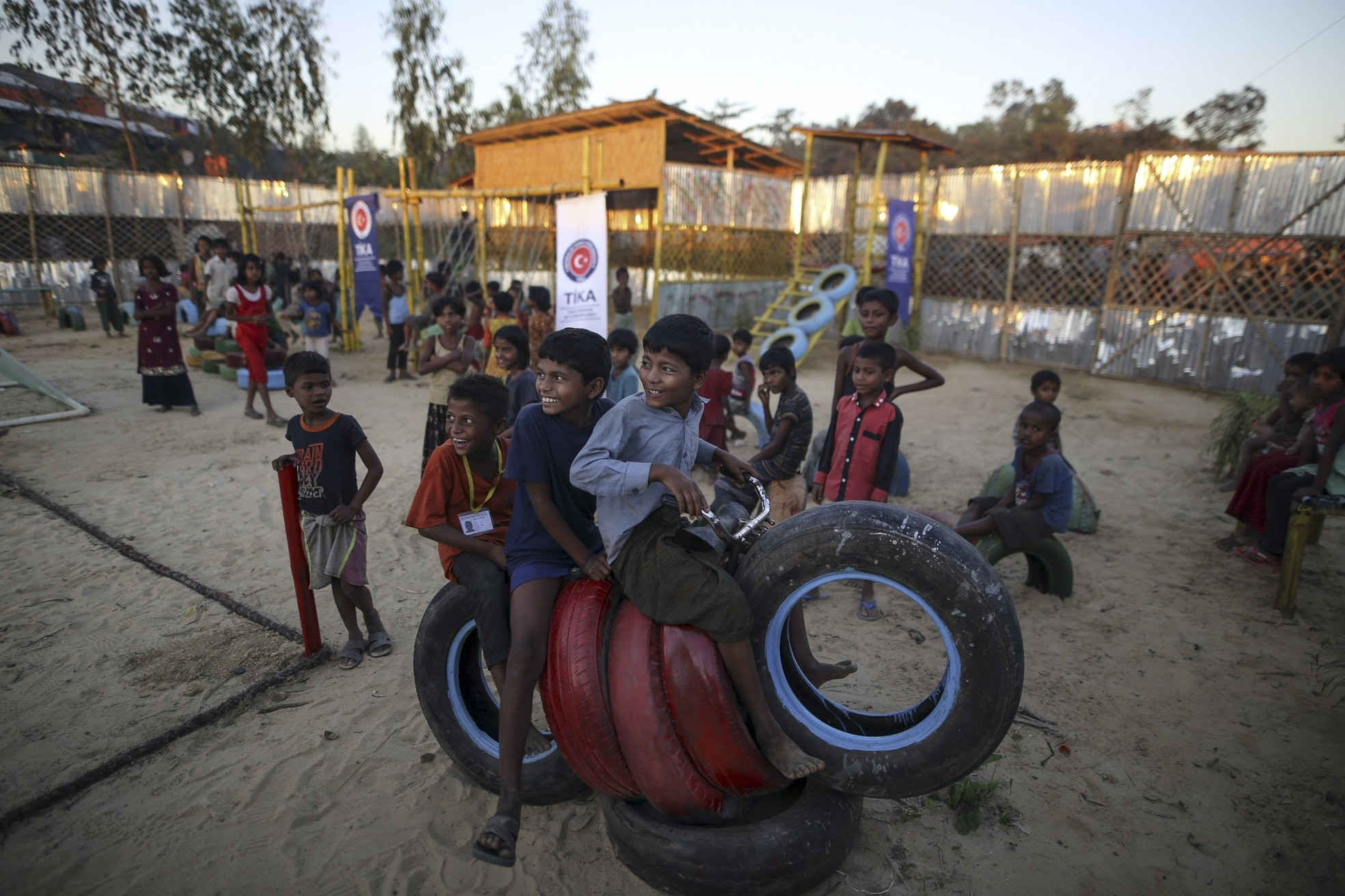 Children of Rohingya refugees in Bangladesh play in a playground furnished by Tu0130KA.