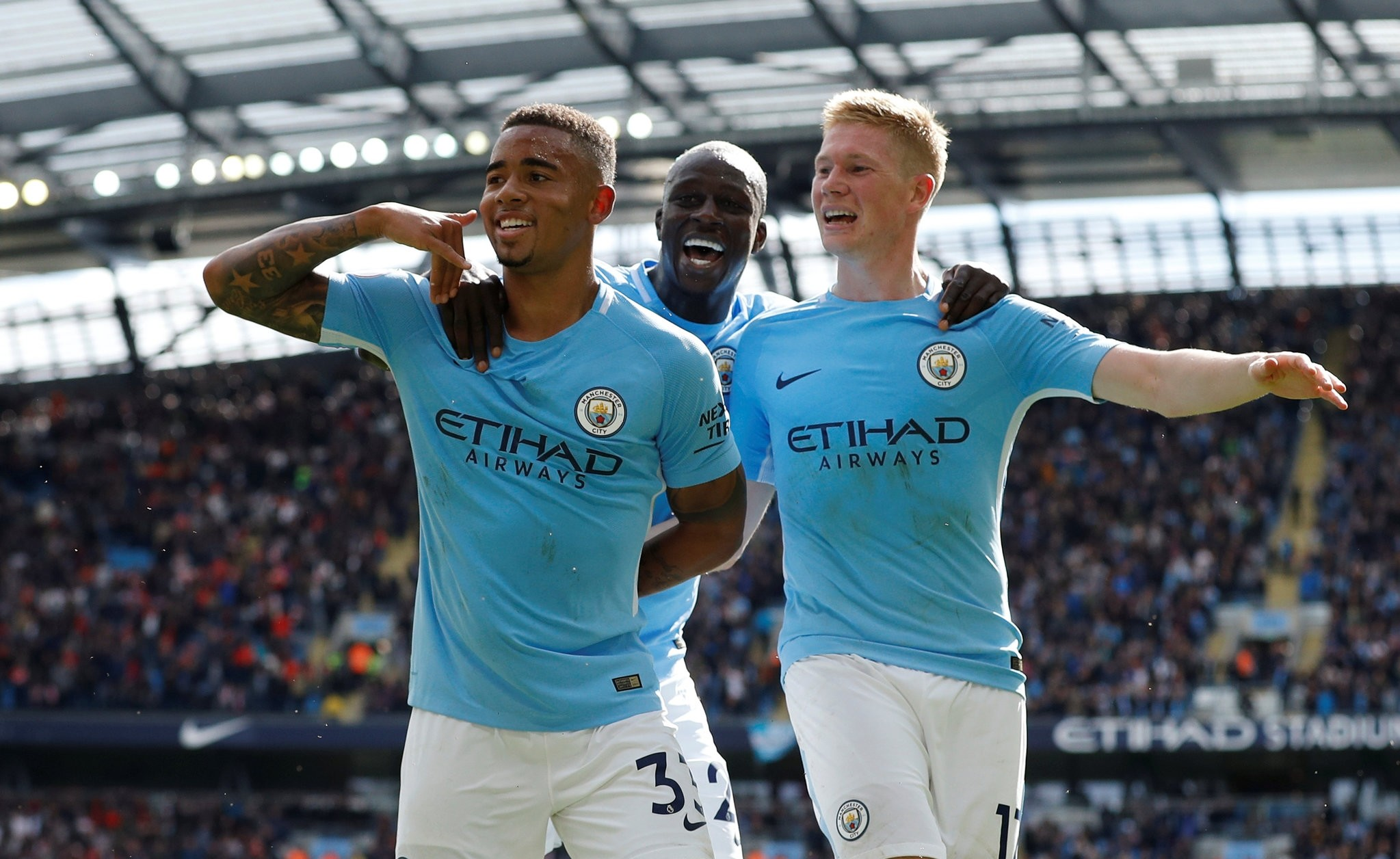 Manchester City's Gabriel Jesus celebrates scoring their second goal with Benjamin Mendy and Kevin De Bruyne. (REUTERS Photo)