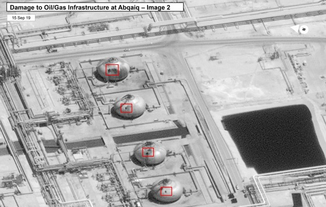 This image provided on Sunday, Sept. 15, 2019, by the U.S. government and DigitalGlobe and annotated by the source, shows damage to the infrastructure at Saudi Aramco's Abaqaiq oil processing facility in Buqyaq, Saudi Arabia. AP Photo