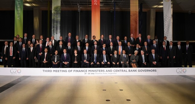 Family picture of Finance Ministers and Central Bank Governors of the G20, during their meeting in Buenos Aires, on July 21, 2018. (AFP Photo)