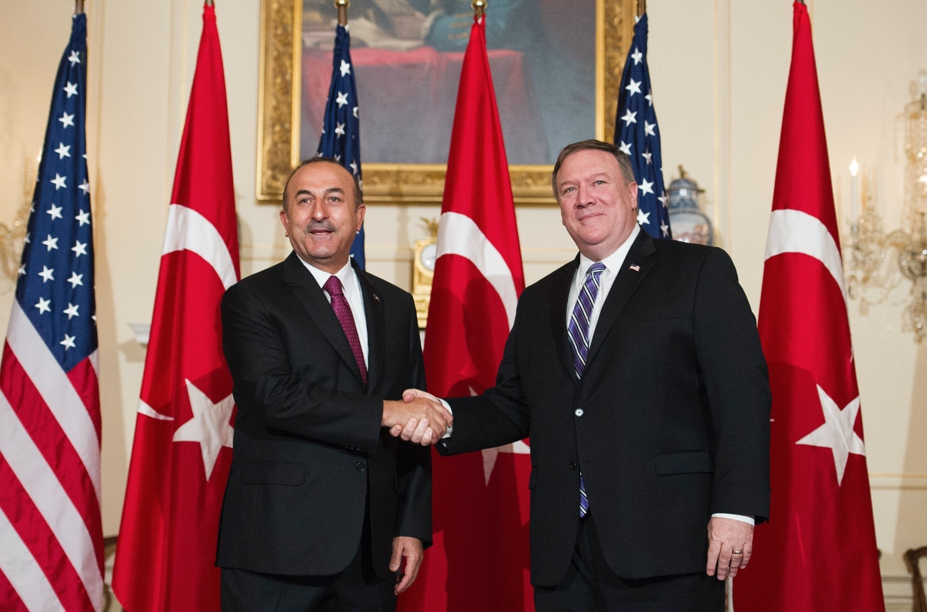 Foreign Minister Mevlu00fct u00c7avuu015fou011flu (L) with Secretary of State Mike Pompeo in the State Department in Washington, June 4.