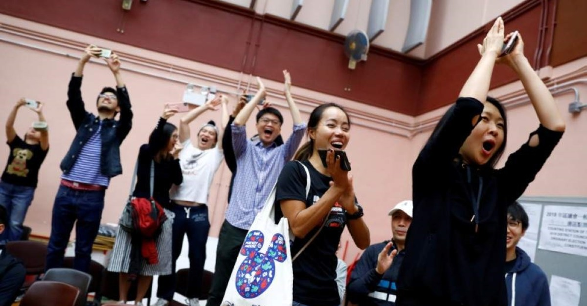Supporters of local candidate Kelvin Lam celebrate after it was announced he won the local council elections in his district, at a polling station in the South Horizons West district in Hong Kong, China, Nov. 25, 2019. (Reuters Photo)