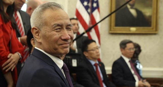 In this Oct. 11, 2019, file photo, Chinese Vice Premier Liu He listens during a meeting in the Oval Office of the White House with U.S. President Donald Trump in Washington. AP Photo