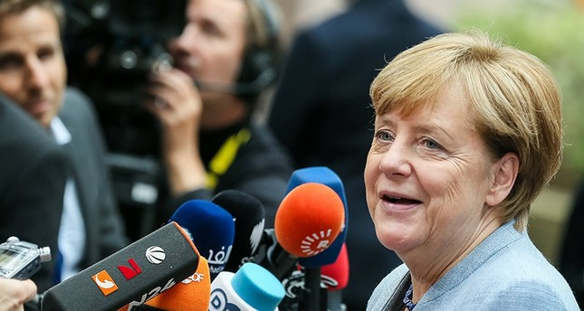 German Chancellor Angela Merkel answers to journalists' questions as she arrives on the first day of the European Council Meeting in Brussels, Oct. 19, 2017 EPA Photo