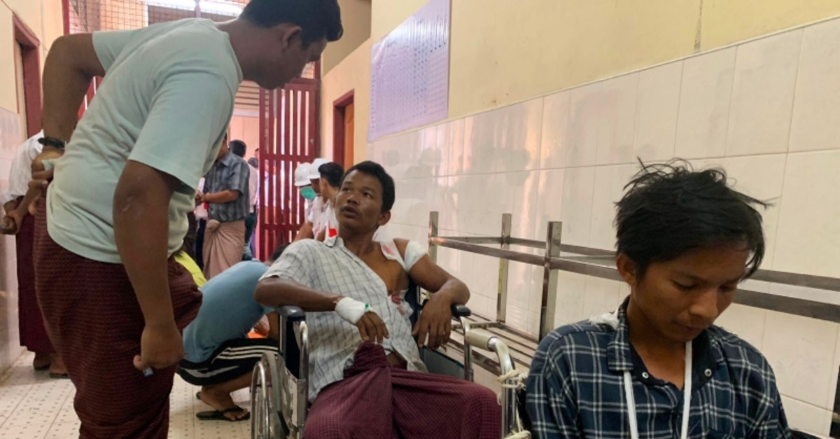 Injured people from Kyauk Tan village in Rathedaung township wait in a hospital in Rakhine state's capital Sittwe in western Myanmar on May 2, 2019. (AFP Photo)