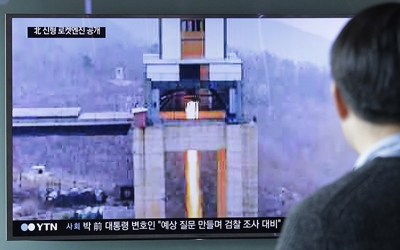 A man watches a TV news program showing an image that North Korea's Rodong Sinmun newspaper reports of a ground test of a new type of high-thrust rocket engine at Seoul Railway station in Seoul, South Korea, Sunday, March 19, 2017. (AP Photo)