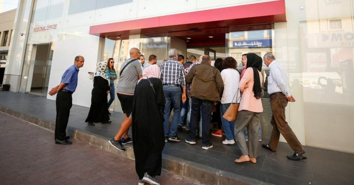 People line up outside a branch of BLC bank in Sidon, Lebanon. (Reuters Photo)