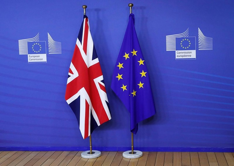 Flags are seen at the EU Commission headquarters ahead of a first full round of talks on Brexit, Britain's divorce terms from the European Union, in Brussels, Belgium July 17, 2017. (Reuters Photo)