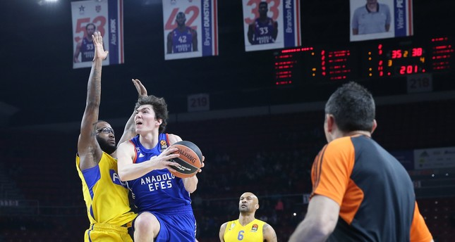 Anadolu Efes's Cedi Osman in action against Maccabi's Victor Rudd in a EuroLeague match, March 17.