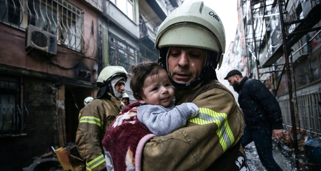 A firefighter saves a baby from house fire due to a natural gas explosion, Fatih, Istanbul.