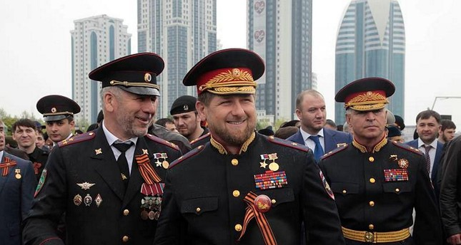 Chechen regional leader Kadyrov, center, wearing a Russian uniform, attends celebrations marking the 70th anniversary of the victory over Nazi Germany, in Russia. (AP Photo)