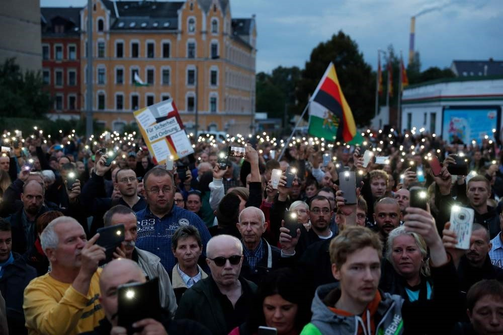 The far-right group ,Pro Chemnitz, stage a protest at the entrance to the stadium of Chemnitz FC, Aug. 30.