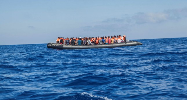A raft with 129 migrants on board, among them 60 women, sails out of control about 24 kilometers north of al-Khums, Libya, Aug. 1.