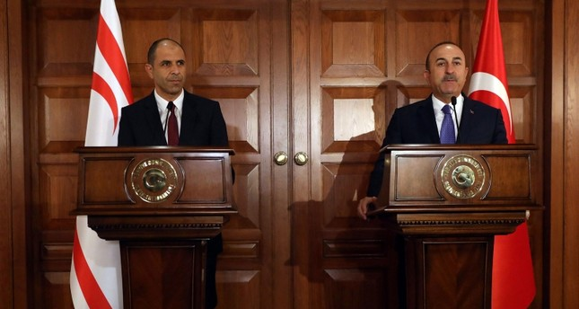 Foreign Minister Mevlüt Çavuşoğlu (R) holds a joint press conference with his Deputy Prime Minister of the Turkish Republic of Northern Cyprus and Minister of Foreign Affairs Kudret Özersay following their meeting in Ankara. (AFP Photo)