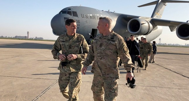 U.S. Army General Joseph Votel (L) walks with U.S. Army Lieutenant General Paul LaCamera commander of the U.S.-led coalition against Daesh, after landing in Baghdad, Iraq February 17, 2019. (REUTERS Photo)
