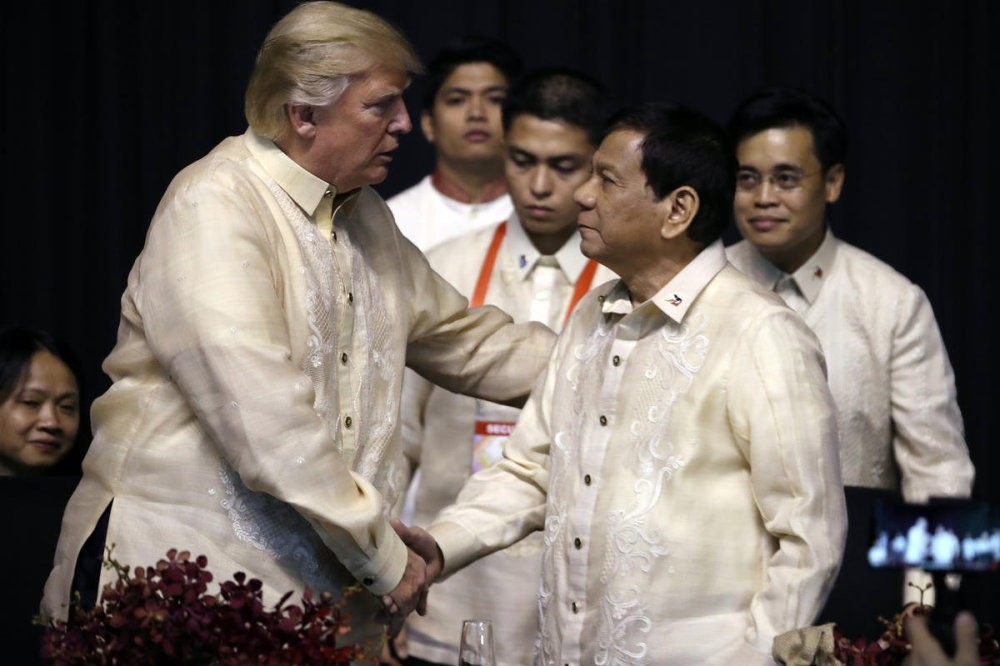 President Trump shakes hands with Philippines President Duterte at an ASEAN Summit dinner at the SMX Convention Center, Manila, Philippines, Nov. 12.