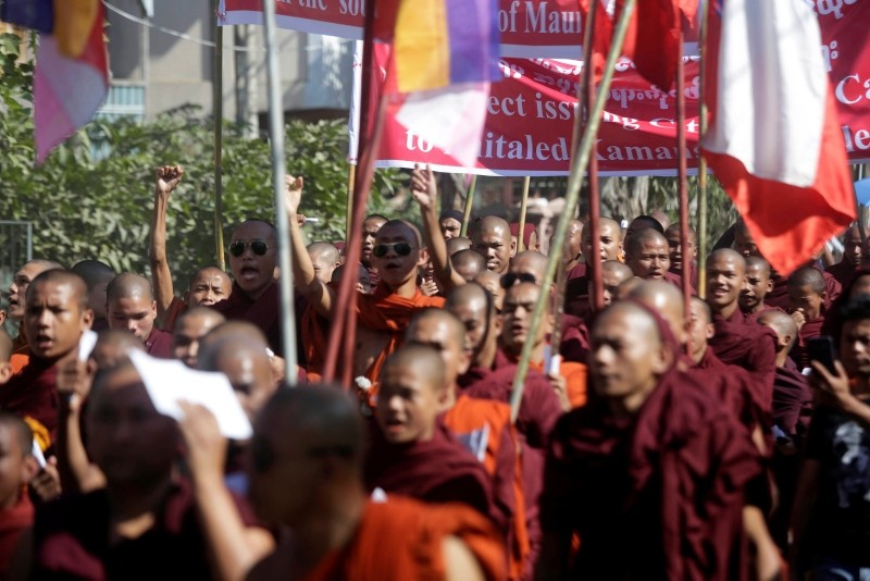 Buddhist monks hold posters and placards during an anti-Rohingya protest in Sittwe, Rakhine State, Myanmar, Nov. 25, 2018. (EPA Photo)