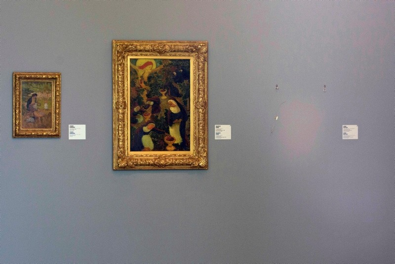 In this Oct. 16, 2012 file photo, the empty space where Henri Matisse' painting ,La Liseuse en Blanc et Jaune, was hanging, right, is seen next to a painting by Maurice Denis, center, and Pierre Bonnard, left,at Kunsthal museum in Rotterdam(AP Photo)