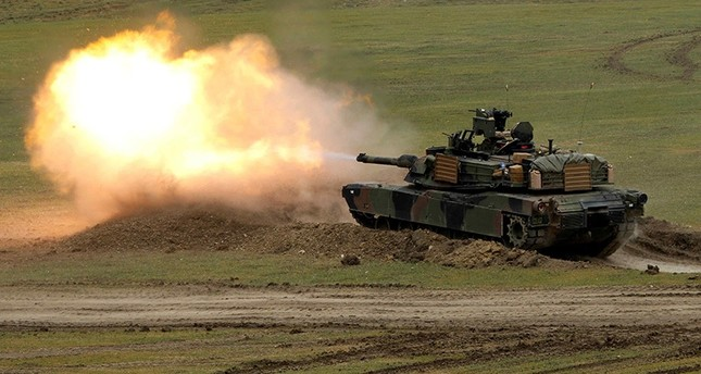 U.S. M1A2 Abrams tank fires during U.S. led joint military exercise Noble Partner 2016 near Vaziani, Georgia, May 18, 2016 (Reuters Photo)