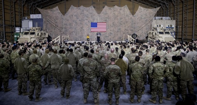 In a surprise visit to the U.S.' al-Asad Air Base in Iraq, U.S. President Donald Trump defended his decision to withdraw U.S. troops from Syria, Dec. 26.