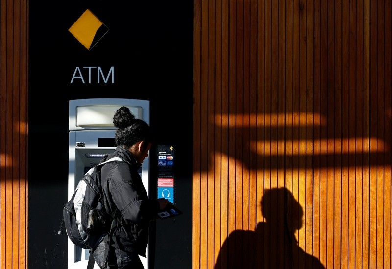 A woman leaves a Commonwealth Bank of Australia ATM in central Sydney (Reuters File Photo)