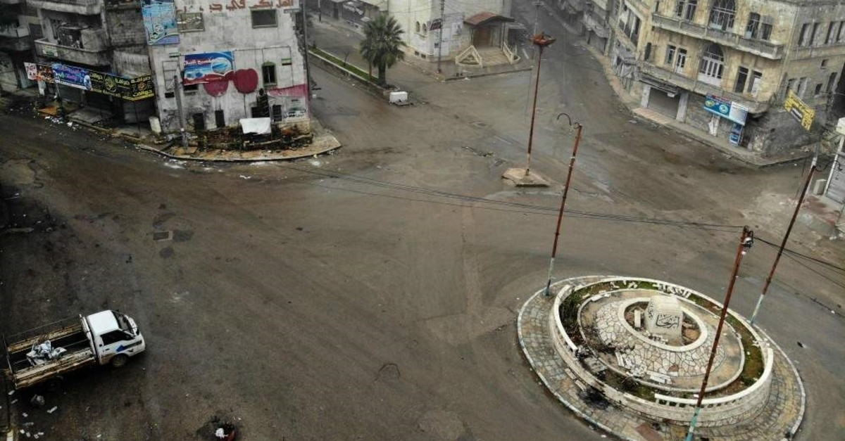 An aerial view taken on February 5, 2020, shows empty streets in the opposition-held town of Ariha in the northern countryside of Syria's Idlib province following an airstrike by pro-regime forces. (Photo by Omar HAJ KADOUR / AFP)