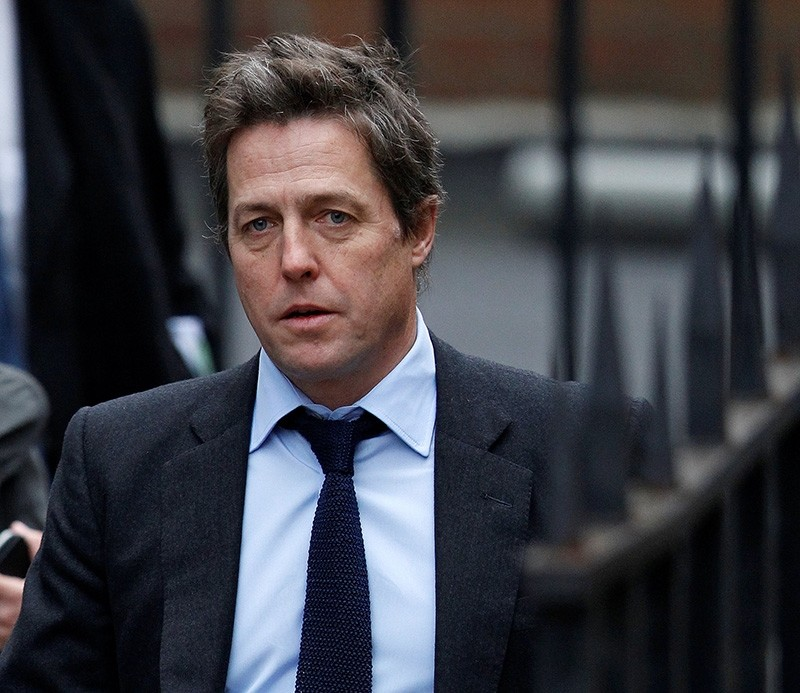British actor Hugh Grant arrives at the Leveson Inquiry at the High Court in central London, Britain, Nov. 21, 2011. (Reuters Photo)