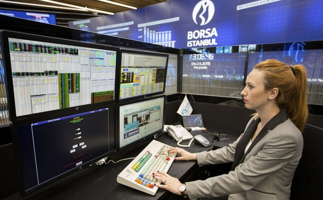 A trader works in the Borsa Istanbul building. The foreign exchange rate on the Borsa Istanbul reached its highest level since November 2015 with a 65.2 percent in April.